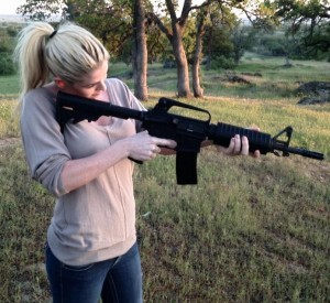 Carly Lauren playing with her new AR-15