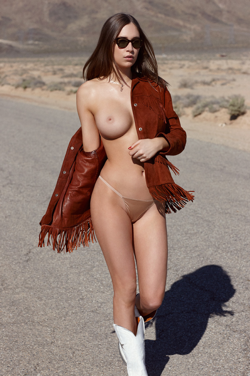 Head on out the highway with June Playmate 2017 Elsie Hewitt, even if she has to hoof it.